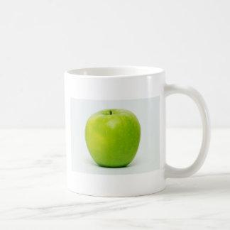 una manzana al día guarda al doctor en la bahía taza