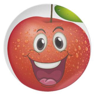 Una manzana sonriente plato de cena