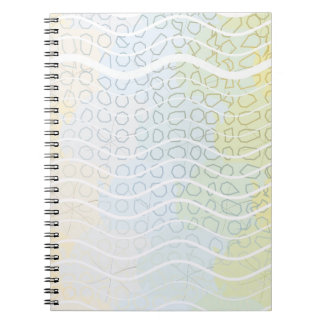 Una mezcla de azules y de amarillos cuadernos
