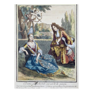 Una mujer asentada en la hierba postales