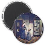 Una mujer con un niño en una despensa. [1] Por Pie Imán De Frigorifico