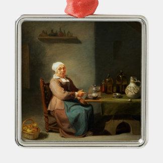 Una mujer en una cocina adorno cuadrado plateado