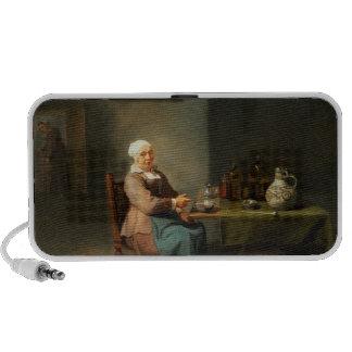 Una mujer en una cocina notebook altavoces