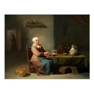 Una mujer en una cocina postales