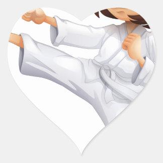 Una mujer joven que hace karate calcomania corazon