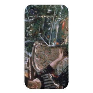 Una mujer que lee cerca de un tanque del Goldfish iPhone 4/4S Carcasas