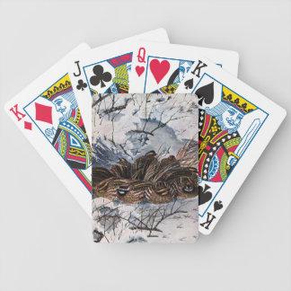 Una nidada de codornices barajas de cartas