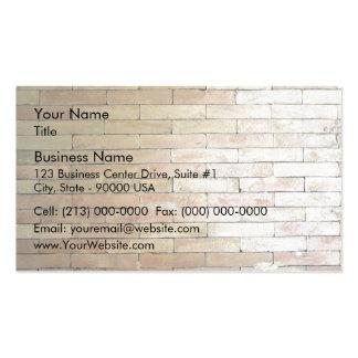 Una pared de ladrillo de color claro tarjetas de visita