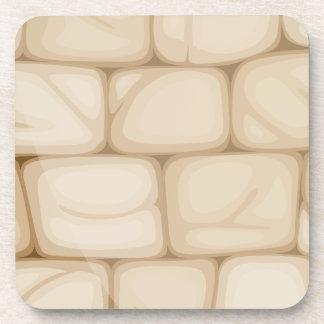 Una pared hecha de ladrillos posavasos