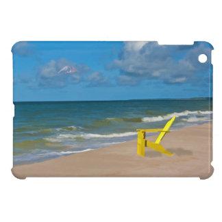 Una playa en alguna parte y silla de playa