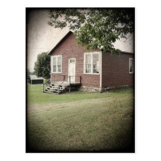 Una postal de la casa de la escuela del sitio