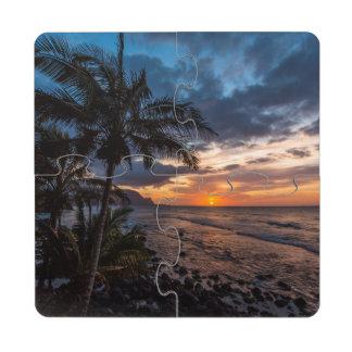 Una puesta del sol hermosa posavasos de puzzle