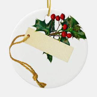 Una puntilla del acebo con una nota adorno navideño redondo de cerámica