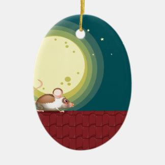 Una rata en el tejado adorno navideño ovalado de cerámica