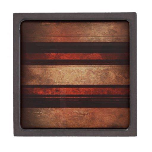 Una raya negra y rojo en un fondo de madera cajas de joyas de calidad