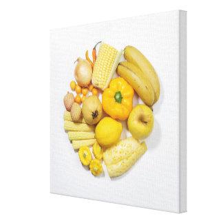 Una selección de frutas y de verduras amarillas impresión en lona estirada