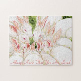 Una semejanza de familia - conejos blancos puzzle con fotos