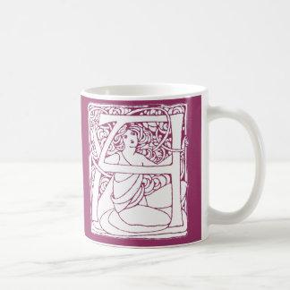 Una señora de la letra taza de café