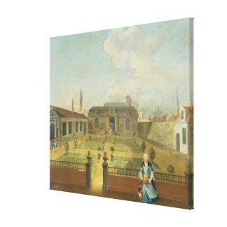 Una señora joven con su perro delante de un jardín lona envuelta para galerias