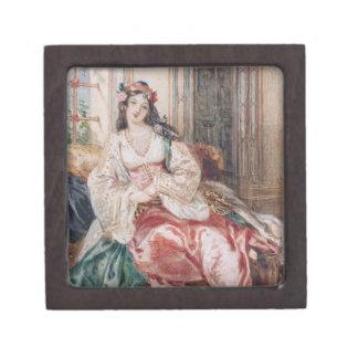 Una señora Seated en un otomano Turki que lleva in Cajas De Recuerdo De Calidad