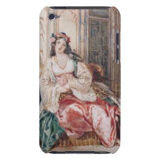 Una señora Seated en un otomano Turki que lleva in Case-Mate iPod Touch Cárcasas