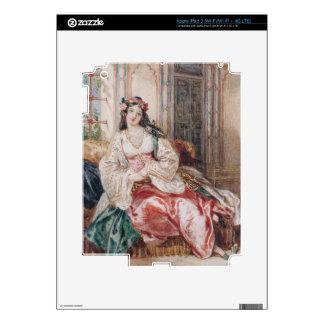 Una señora Seated en un otomano Turki que lleva in iPad 3 Skins