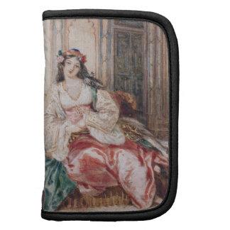 Una señora Seated en un otomano Turki que lleva in Planificadores