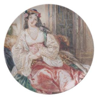 Una señora Seated en un otomano Turki que lleva in Plato