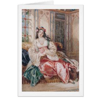 Una señora Seated en un otomano Turki que lleva in Tarjeta De Felicitación