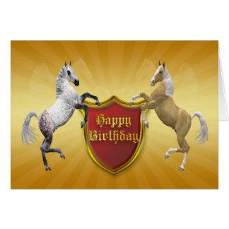 Una tarjeta de cumpleaños con un escudo de armas