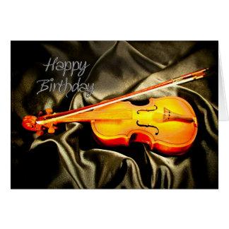 Una tarjeta de cumpleaños musical con un violín