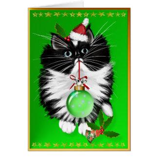 Una tarjeta de las Felices Navidad del smoking