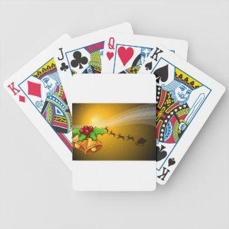 Una tarjeta de Navidad con las campanas y un Baraja Cartas De Poker