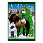 Una tarjeta de Navidad del caballo y del niño
