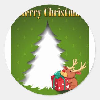 Una tarjeta de Navidad verde con un reno que Pegatina Redonda