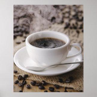 Una taza de café póster