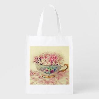 Una taza de té del vintage de flores bolsas de la compra