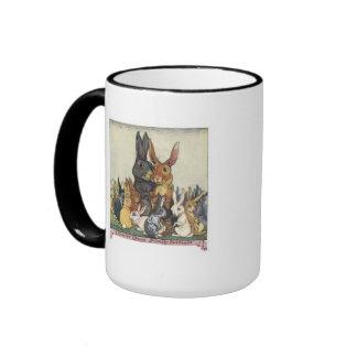 Una taza del retrato de la familia del conejito