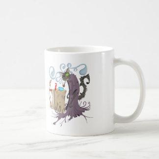 Una taza observada del Puss