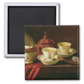 Una tetera de Yixing y una porcelana china Tete-a- Imán Cuadrado