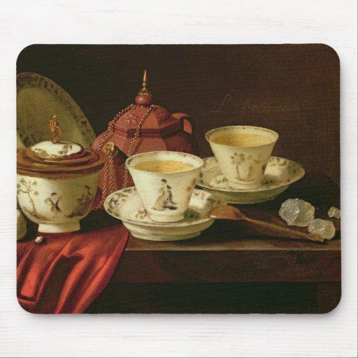 Una tetera de Yixing y una porcelana china Tete-a- Tapete De Ratón