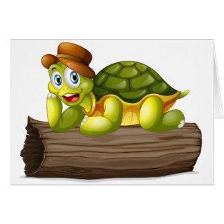 Una tortuga sobre un registro tarjeta de felicitación