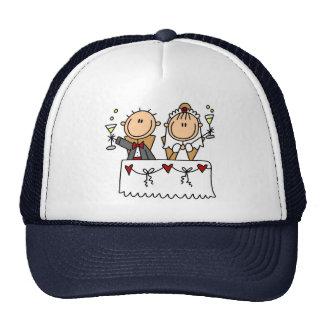 Una tostada al gorra de novia y del novio