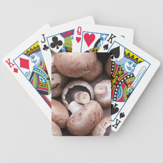 Uncooked fresh mushrooms bicycle playing cards