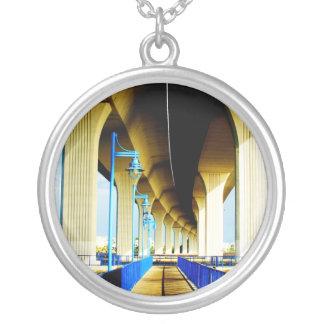 Under bridge blue lights and walkway photo round pendant necklace