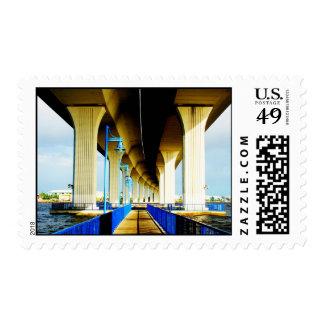 Under bridge blue lights and walkway photo stamp