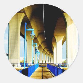 Under bridge blue lights and walkway photo round sticker