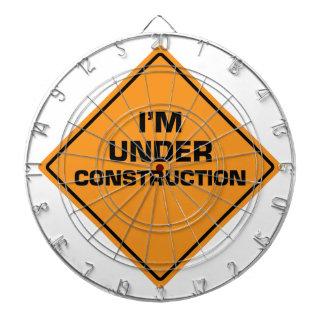 Under Construction Dartboard With Darts