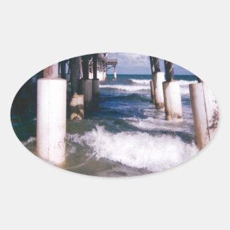 Under the Pier Oval Sticker