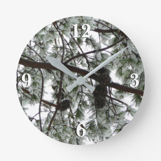 Underneath the Snow Covered Pine Tree Winter Photo Round Clock